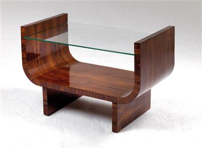 A side table with raised sides, - Design