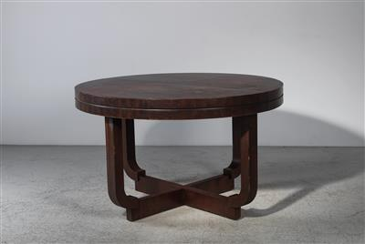 "A round extension table (so-called ""Kulissentisch"") on X-base, mod. 357/31 from dining room 357, designed by Bruno Paul - Design"